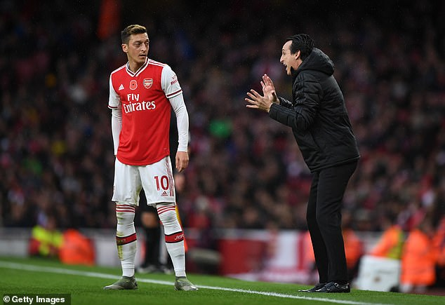 Spanish coach Unai Emery (right) claimed that he was destined to fail at Arsenal